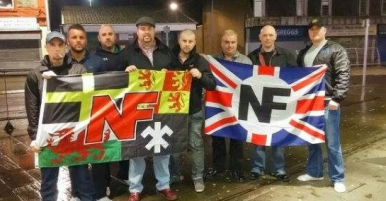 NF Wales in Merthyr, 2015, dragging Welsh symbols through the dirt